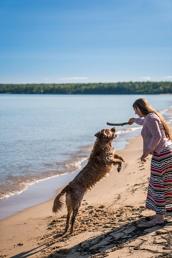 Lake Superior summer beach day with golden retriever dog on Michigan's Upper Peninsula.