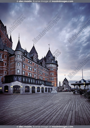Boardwalk of Dufferin terrace by the Fairmont Le Château Frontenac castle at dusk with dramatic sky, luxury grand hotel Chateau Frontenac, National Historic Site of Canada. Old Quebec City, Quebec, Canada. Terrasse Dufferin, Ville de Québec.