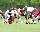 Ashburn, VA - May 2, 2009 -- Running back Clinton Portis (26) shares some thoughts with offensive tackle Chris Samuels (60) as they do warm-up exercises prior to participating in the 2009 Washington Redskins mini-camp at Redskins Park in Ashburn Virginia on Saturday, May 2, 2008..Credit: Ron Sachs / CNP