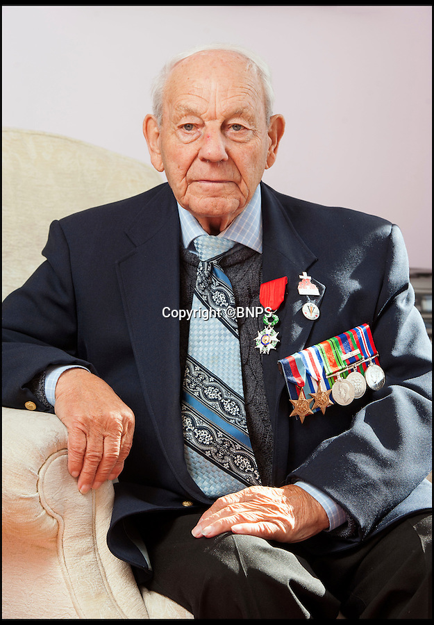 BNPS.co.uk (01202 558833)Pic: TomWren/BNPS<br /> <br /> A D-Day hero who captured the tallest soldier in the German army in a comic David v Goliath moment has been awarded France's top honour 70 years later.<br /> <br /> Corporal Bob Roberts, 92, from Bournemouth, was one of the first troops to step foot on the Normandy beaches and fought throughout France, often leading a charmed life.<br /> <br /> He has now been awarded the Legion d'Honneur by the French government.
