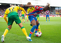 Norwich City Emiliano Buendia no17 and Crystal Palace Wilfried Zaha during the Premier League match between Crystal Palace and Norwich City at Selhurst Park, London, England on 28 September 2019. Photo by Andrew Aleksiejczuk / PRiME Media Images.