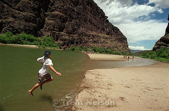Mikey Hightower jumps into the river on a Native American river trip through Lodore Canyon and Dinosaur National Monument.<br />