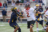 College Park, MD - April 1, 2017: Maryland Terrapins Colin Heacock (2) fights off Michigan Wolverines Chase Yound (3) during game between Michigan and Maryland at  Capital One Field at Maryland Stadium in College Park, MD.  (Photo by Elliott Brown/Media Images International)