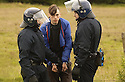 06/07/2005         Copyright Pic : James Stewart.File Name : sct_jspa17 g8 stirling.POLICE ARREST PROTESTERS AFTER THEY BLOCKED THE M9 MOTORWAY AT CAMBUSBARRON NEAR STIRLING....Payments to :.James Stewart Photo Agency 19 Carronlea Drive, Falkirk. FK2 8DN      Vat Reg No. 607 6932 25.Office     : +44 (0)1324 570906     .Mobile   : +44 (0)7721 416997.Fax         : +44 (0)1324 570906.E-mail  :  jim@jspa.co.uk.If you require further information then contact Jim Stewart on any of the numbers above.........