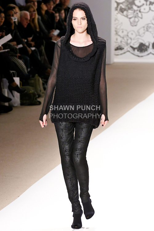 Marina Jamieson walks the runway in a stretch chiffon transparent top with thumb keyhole in black, chunky knit hooded sweater in black, with Hansel and Gretel sheer skinny pant, by Wenlan Chia, for the Twinkle By Welan Fall 2010 fashion show, during Mercedes-Benz Fashion Week Fall 2010.