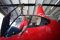 NWA Democrat-Gazette/DAVID GOTTSCHALK   Camron McAhren (right), operations director at Arkansas Helicopters of Springdale, sits in one of the helicopters Tuesday, February 7, 2017, based at the Springdale Municipal Airport. For the third year, the company is offering Valentine's Day flights.