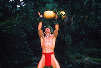 "Hawaiian """"warrior"""" hula dancer in red loin cloth with gourd instrument"