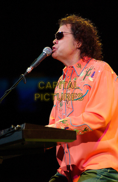 RONNIE MISLAP.Country music star RONNIE MILSAP performs as opening act for George Strait's 2007 Tour held at the Mellon Pittsburgh, PennsylvaniaL, USA,.16 February 2007..half length orange shirt keyboard sunglasses concert on stage funny mouth .CAP/ADM/JN.©Jason L Nelson/AdMedia/Capital Pictures.