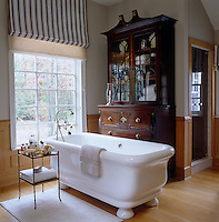 In the master bathroom a 19th century English secretary makes a surprising focal point