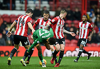 Preston's Callum Robinson forced off the ball by Brentford's Josh McEachran and John Egan<br /> <br /> Photographer Jonathan Hobley/CameraSport<br /> <br /> The EFL Sky Bet Championship - Brentford v Preston North End - Saturday 10th February 2018 - Griffin Park - Brentford<br /> <br /> World Copyright &copy; 2018 CameraSport. All rights reserved. 43 Linden Ave. Countesthorpe. Leicester. England. LE8 5PG - Tel: +44 (0) 116 277 4147 - admin@camerasport.com - www.camerasport.com