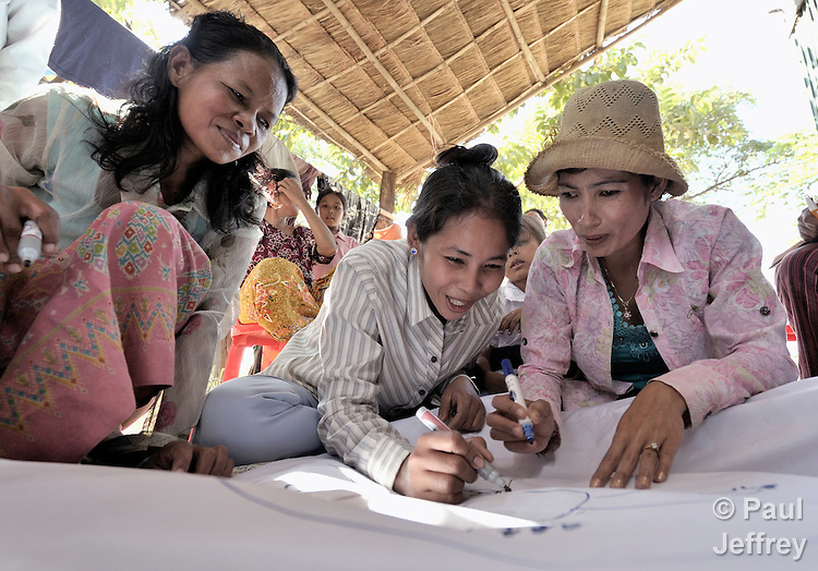 Women participate in a Bible study sponsored by the Methodist Church in the Cambodian village of Bour.
