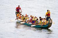 Asian dragon racing boat being steered into dock area. Dragon Festival Lake Phalen Park St Paul Minnesota USA