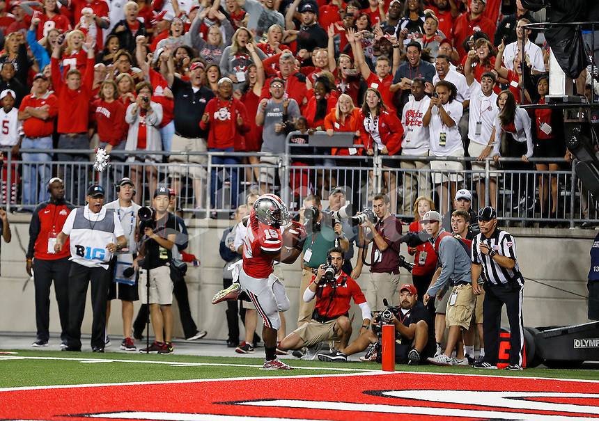 Ohio State Buckeyes running back Ezekiel Elliott (15) scores a touchdown against Virginia Tech Hokies in the 4th quarter of their game in Ohio Stadium on September 6, 2014.  (Dispatch photo by Kyle Robertson)