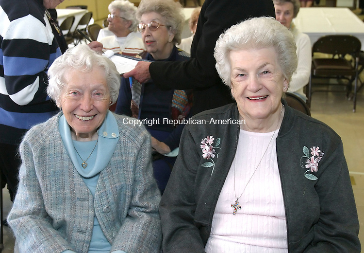 WATERBURY, CT 4/10/07- 041007BZ06- From left- Nan Tarullo, of Waterbury, and Lucille Russell, of Naugatuck, <br /> during a meeting celebrating the 118th birthday of the Waterbury Women's Club Tuesday.   The event was held at the First Congregational Church on West Main Street <br /> Jamison C. Bazinet Republican-American