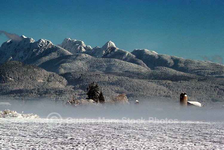 Fraser Valley, BC, British Columbia, Canada - 'Golden Ears' Mountain (Coast Mountains) and Winter Fog on Farm