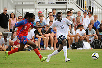 Fuad Ibrahim (19) of the USA is trailed by Roy Alexander Smith (3) of Costa Rica. The US U-20 Men's National Team defeated the U-20 Men's National Team of Costa Rica 2-1 in an international friendly during day four of the US Soccer Development Academy  Spring Showcase in Sarasota, FL, on May 25, 2009.