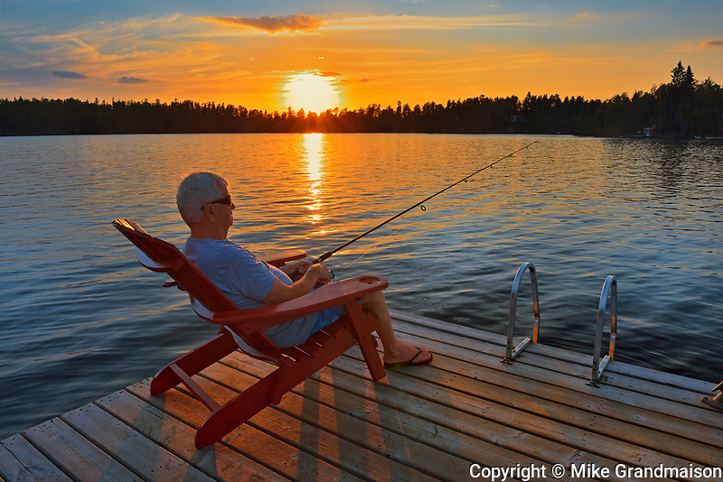 Fishing on dock on Star Lake at sunset<br />