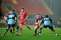Ken Owens of Scarlets is tackled by Nick Williams of Cardiff Blues during the Guinness Pro14 match between the Scarlets and Cardiff Blues at Parc Y Scarlets, Llanelli, Wales, UK. Saturday 22 December 2018