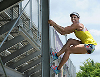 NWA Democrat-Gazette/ANDY SHUPE<br /> April Steiner Bennett, a former Arkansas and Olympic pole vaulter, poses Friday, June 16, 2017, at Ramay Junior High School in Fayetteville. Steiner Bennett competed in the ninth season of American Ninja Warrior.