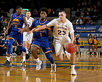 SIOUX FALLS, SD - NOVEMBER 28: Owen King #23 from South Dakota State University drives against Xavier Bishop #0 from UMKC during their game Wednesday night at Frost Arena in Brookings, SD. (Photo by Dave Eggen/Inertia)