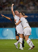 USWNT midfielder (9) Heather O'Reilly celebrates a goal with teammate (5) Lindsay Tarpley while playing at Shanghai Stadium.  The US defeated Canada, 2-1, in extra time and advanced to the semifinals during the 2008 Beijing Olympics in Shanghai, China.