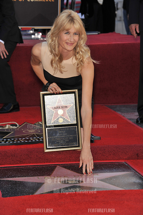 Laura Dern on Hollywood Boulevard where, together with her parents Bruce Dern & Diane Ladd, she was honored with a star on the Hollywood Walk of Fame. This was the first time in history that three stars from the same Hollywood family dynasty of actors was honored at the same time..The Hollywood Walk of Fame is celebrating its 50th anniversary this month..November 1, 2010  Los Angeles, CA.Picture: Paul Smith / Featureflash