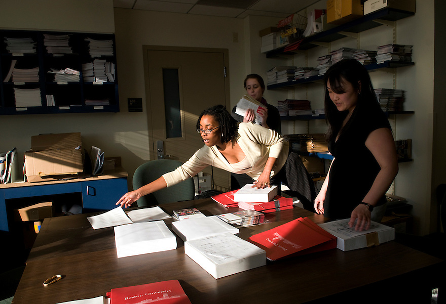 BOSTON, MA.--March 17, 2009--Boston University Admissions Coordinators from left,  Sarauna Moore and Sarah Thomson[CQ] arrange material to be assembled into admissions packets. CREDIT: JODI HILTON FOR THE NEW YORK TIMES