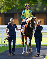 Winner of The T & M Glass Ltd and TDK Novice Median Auction Stakes   Jersey Wonder ridden by Rossa Ryan and trained by Jamie Osborne is led into the winners enclosure during Twilight Racing at Salisbury Racecourse on 14th September 2018