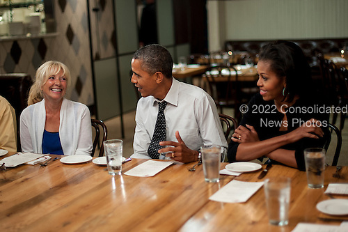 """United States President Barack Obama and First Lady Michelle Obama have dinner with three winners of """"Dinner with Barack and Michelle"""" fundraising contest at Mintwood Place in Washington, D.C., U.S., on Monday, Aug. 20, 2012. .Credit: Pete Marovich / Pool via CNP"""