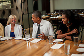 "United States President Barack Obama and First Lady Michelle Obama have dinner with three winners of ""Dinner with Barack and Michelle"" fundraising contest at Mintwood Place in Washington, D.C., U.S., on Monday, Aug. 20, 2012. .Credit: Pete Marovich / Pool via CNP"