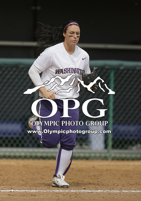 23 May 2010:  Washington Huskies pitcher Danielle Lawrie runs onto the field against the University of North Carolina.  Washington defeated the University of North Carolina 2-1 in eight innings at Husky Softball Stadium in Seattle, WA to advance in the NCAA regional tournament.