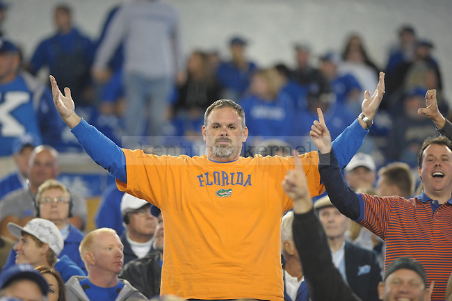 Florida fan throws up his arms during the second half of the University of Kentucky football game against Florida at Commonwealth Stadium in Lexington, Ky., on 9/24/11. UK lost the game 10-48. Photo by Mike Weaver | Staff