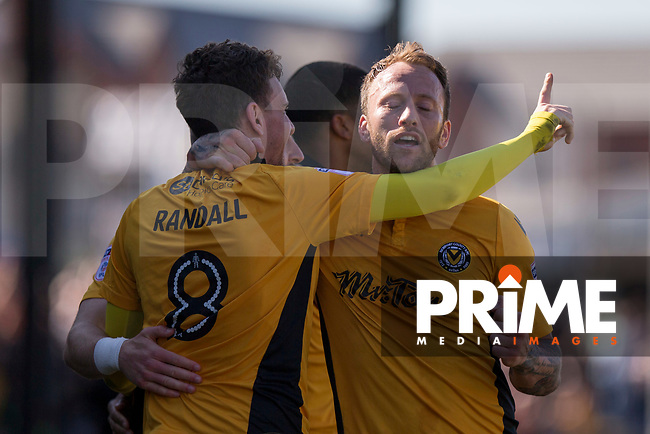 Mark Randall of Newport County celebrates his side's first goal with Sean Rigg during the Sky Bet League 2 match between Newport County and Accrington Stanley at Rodney Parade, Newport, Wales on 22 April 2017. Photo by Mark  Hawkins.