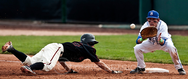 Photo by Chris Detrick | The Salt Lake Tribune .American Fork's Jeremy Reynolds (24) slides safely back to first bast past Bingham's Josh Sandquist (15) during the game 5A at Brent Brown Ballpark Thursday May 26, 2011. Bingham won the game 7-0.