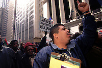 (020301-SWR04.jpg) 3 Mar 99 -- New York, NY -- Demonstrators rally on Wall Street to protest the Police killling of African immigrant Amadou Diallo. Diallo, who was unarmed,  died after an NYPD Street Crime Unit fired 41 bullets at him in the vestibule of his Bronx apartment building.