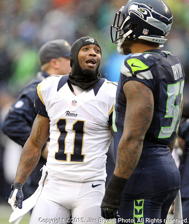 Seattle Seahawks linebacker Bruce Irvin, right, and St. Louis Rams Tavon Austin (11) joke around during an injury time out at CenturyLink Field in Seattle, Washington on December 27, 2015.  The Rams beat the Seahawks 23-17.      ©2015. Jim Bryant Photo. All Rights Reserved