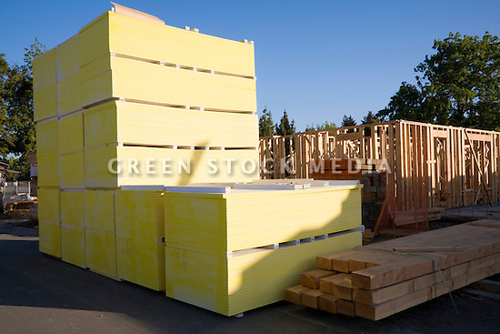 Stacks of Georgia-Pacific Gypsum DensGlass exterior sheathing drywalls. The real estate developer D. R. Horton's 181-unit housing development Arbor Real is under construction. The project consists of luxury townhouses and condominiums on the site of the former Rickey's Hyatt adjacent to El Camino Real. Palo Alto, California, USA