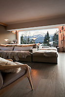 The large picture window in the living area offers stunning views of the snow capped mountains around Cortina D'Ampezzo