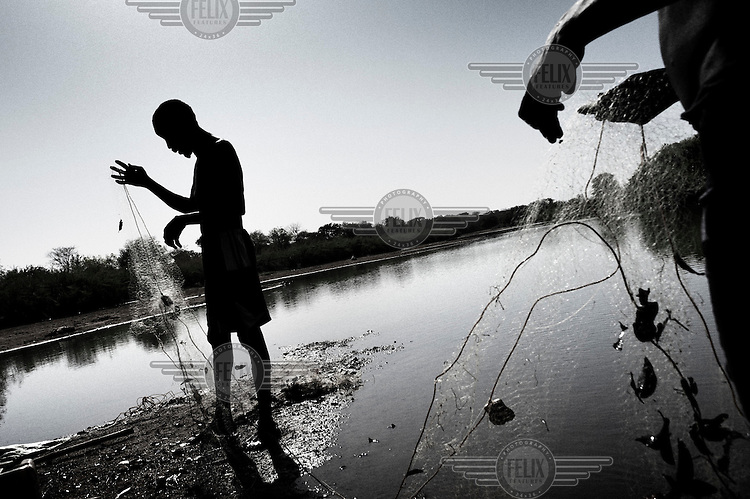 South Sudan. 18 March 2011...Fishermen in low waters of the river Jur, a Nile tributary, in the western state of Bahr el Ghazal.