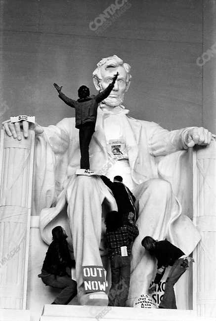 Anti-Vietnam War protests climb the Lincoln Memorial during the inauguration ceremony of President Richard Nixon's second term, Washington D.C., January 20, 1973