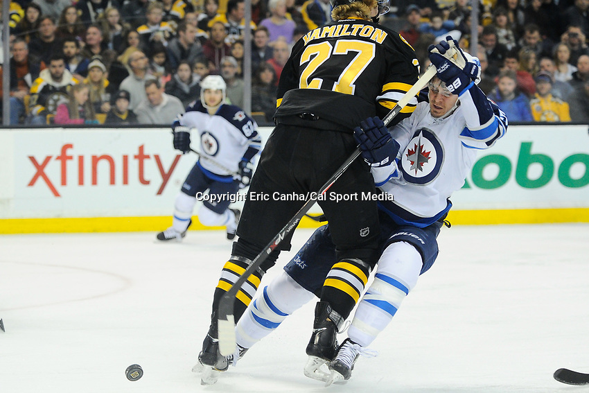 January 2, 2014 - Boston, Massachusetts, U.S. - Boston Bruins defenseman Dougie Hamilton (27) and Winnipeg Jets center Mark Scheifele (55) collide  during the NHL game between Winnipeg Jets and the Boston Bruins held at TD Garden in Boston Massachusetts.  Boston defeated Winnipeg 4-1 in regulation. Eric Canha/CSM