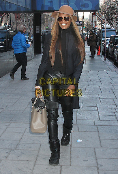 NEW YORK, NY - JANUARY 5: Cynthia Bailey, star of 'The Real Housewives of Atlanta' spotted leaving 'Good Day New York' wearing sunglass from the Cynthia Bailey Eyewear collection in New York, New York on January 5, 2016. <br /> CAP/MPI/RMP<br /> &copy;RMP/MPI/Capital Pictures