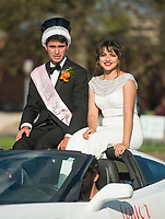 NWA Democrat-Gazette/BEN GOFF @NWABENGOFF<br /> Omar Silva, Rogers Heritage homecoming king, and Jeanette Salinas ride in the school's homecoming parade Friday, Oct. 5, 2018, through downtown Rogers. This year's parade had a 'Candyland' theme.