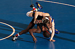 12 MAR 2011:  Mario Morgan of Nebraska-Omaha (in black) wrestles Dalton Jensen of Nebraska-Kearney during the Division II Men's Wrestling Championship held at the UNK Health and Sports Center on the University of Nebraska - Kearney campus in Kearney, NE.  Morgan defeated Jensen 12-5 to win the 141-lb national title. Corbey R. Dorsey/ NCAA Photos