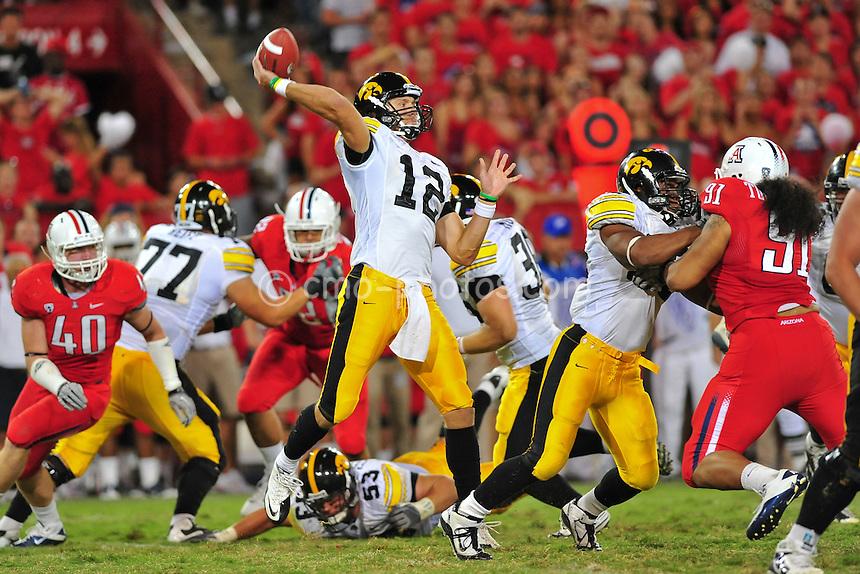 Sept 18, 2010; Tucson, AZ, USA; Iowa Hawkeyes quarterback Ricky Stanzi (12) throws a pass in the 3rd quarter of a game against the Arizona Wildcats at Arizona Stadium. Arizona won the game 34-27.