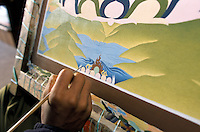 A refugee working on a Buddhist Thangka in the Tibetan neighbourhood in Eastern of Kathmandu, Nepal. The lamas who paint thangkas use painting as a form of spiritual education and can spend up to 9 months on each canvas. Thangkas are seen hanging in every temple, monastery and family shrine in Tibet and Nepal.