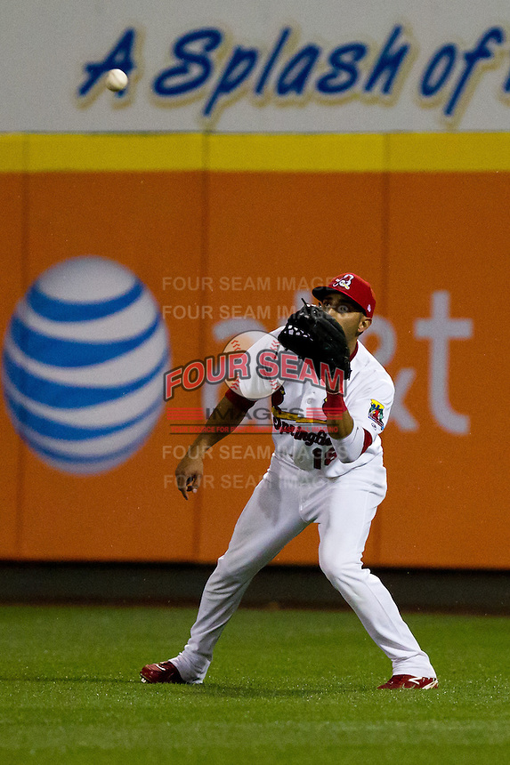 Alex Castellanos (18) of the Springfield Cardinals eyes a fly ball to right field during a game against the Frisco RoughRiders on April 14, 2011 at Hammons Field in Springfield, Missouri.  Photo By David Welker/Four Seam Images.