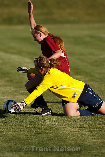 Sandy - Waterford's Lanie Ward and Salem Hills goalkeeper Sam Bigler fight for the ball. Waterford vs. Salem Hills girls high school soccer, 3A playoffs, Wednesday, October 15, 2008. Waterford wins at home 7-1..
