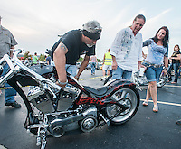 NWA Democrat-Gazette/ANTHONY REYES &bull; @NWATONYR<br /> Darryl Gibbs of Springdale, from left, talks with Derek Burden and his wife Saunya Burden, both of Bella Vista, Tuesday, Sept. 22, 2015 about Gibbs custom motorcycle during the unofficial kickoff for the Bikes, Blues and BBQ rally at Jose&rsquo;s Southwest Grill in Springdale. Gibbs motocycle is a 2006 custom motorcycle by Joe Martin in Duncan, Texas. The event featured hundreds of motorcyclists, live music, a &quot;Bike of the Year&quot; contest and a motorcycle give away.