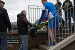 Edinburgh University 3 Selkirk 2, 13/03/2016. Peffermill, Scottish Lowland League. Visiting striker Garry O'Connor helping a man carrying a child in a pram up a stairway before Edinburgh University took on Selkirk in a Scottish Lowland League match at Peffermill, Edinburgh in a game the hosts won 3-2. The match was one of six attended by members of GroundhopUK over the weekend to accommodate groundhoppers, fans who attempt to visit as many football venues as possible. Around 100 fans in two coaches from England participated in the 2016 Lowland League Groundhop and they were joined by other individuals from across the UK which helped boost crowds at the six featured matches. Photo by Colin McPherson.